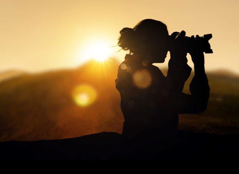 Fotomotive Inspiration Frau mit Kamera Silhouette